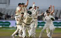 Australia's players celebrate their victory on the field after getting a positive review for the final wicket of England's Craig Overton on day five of the fourth Ashes cricket Test match between England and Australia at Old Trafford in Manchester, north-west England on 8 September 2019. Picture: AFP