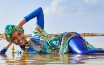 Halima Aden wears a hijab and burkini for Sports Illustrated. Picture: @SI_Swimsuit/Twitter