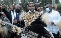Prince Misuzulu Zulu (C) arrives with Zulu regiments to attend the provincial memorial service at the Khangelakamankegane Royal Palace in Nongoma on 7 May 2021 to pay his last respects to his mother, the late Queen Mantfombi Dlamini Zulu of the Zulu nation. Picture: AFP