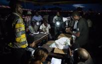 Improvised electoral agents count the ballots after a symbolic vote on 30 December 2018, at Kalinda Stadium in Beni, where voting was postponed for Democratic Republic of Congo's general elections. Picture: AFP