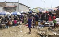 FILE: A young girl walks through the Buracos market, in the Angolan restive region of Cabinda, on 19 April 2019 in Cabinda, Angola. Since he came to power in 2017, Angolan President Joao Lourenco has promoted himself as transparent, moderate leader who is keen to draw a line under the 38-year rule of Jose Eduardo dos Santos. But in the oil-rich province of Cabinda, Lourenco is accused of turning the screws on separatists who say they have been targeted by a new wave of state repression. Picture: AFP