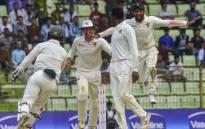 Zimbabwe cricketers celebrate after winning the match on the fourth day of the first Test cricket match between Bangladesh and Zimbabwe in Sylhet on 6 November 2018. Picture: AFP