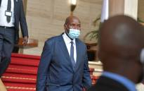 Ivory Coast's Vice President Daniel Kablan Duncan (C) leaves presidential palace in Abidjan on 13 July 2020, after resignation. Picture: AFP