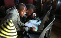 FILE: Learners in the Eastern Cape use chairs as tables due to a lack of furniture in some schools. Picture: Sebabatso Mosamo/EWN