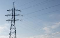 Electricity transmission pole, with clouds in background. Picture: Freeimages.com
