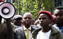 Johannesburg Mayor Herman Mashaba accepts a memorandum from students outside the city's chambers on 27 September 2018. Picture: Kayleen Morgan/EWN