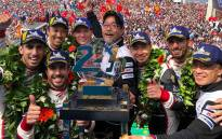 Fernando Alonso (second left) celebrates on the podium with his Toyota teammates after winning the 24 Hours of Le Mans on 17 June 2018. Picture: @alo_oficial/Twitter