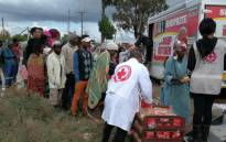 Victims of the recent floods in KwaZulu-Natal receive meals from the Red Cross. Picture: @SARedCross/Twitter