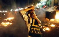 FILE: A supporter of the Muslim Brotherhood and of Egypt's ousted President Mohamed Morsi demonstrates on 16 July, 2013 in the centre of Cairo.Picture:AFP