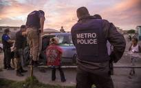 Members of Cape Town's Gang and Drug Taskforce stop and search suspects in Manenberg. Picture: Thomas Holder/EWN