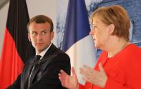 FILE: French President Emmanuel Macron (L) and German Chancellor Angela Merkel give a joint press conference on 19 June 2018, at the Meseberg Palace, northeastern Germany. Picture: AFP