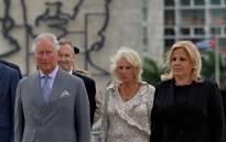 Britain's Prince Charles (L) and his wife Camilla (C), accompanied by Cuba's Deputy Minister of Foreign Affairs Ana Teresita Gonzalez (R), attend the wreath-laying ceremony at Revolution Square in Havana on 24 March 2019. Picture: AFP