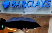A file photograph dated 09 February 2009 shows a pedestrian passing a Barclays bank branch in London, Britain. Picture: EPA/Andy Rain.