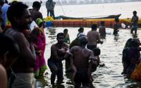 Indian devotees take a dip on the banks of the Triveni Sangam, the confluence of the Ganges, Yamuna and mythical Saraswati rivers, as people gather for the Kumbh Mela festival in Allahabad on 14 January 2019. Picture: AFP