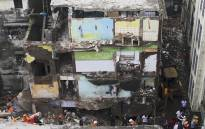 Rescue workers search for survivors in the rubble of a collapsed three-storey residential building in Bhiwandi on 21 September 2020. Picture: AFP.