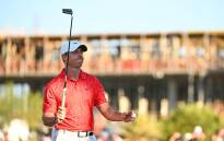 Rory McIlroy of Northern Ireland waves in celebration of winning on the 18th green during the final round of THE CJ CUP @ SUMMIT at The Summit Club on 17 October 2021 in Las Vegas, Nevada. Picture: Alex Goodlett/Getty Images via AFP