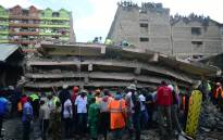 Rescue workers attend to the scene of a six-storey building that collapsed in Nairobi, on 6 December 2019. Picture: AFP