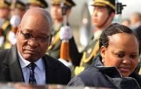 President Jacob Zuma accompanied by his wife MaNtuli arrive at Sanya Phoenix International Airport in China. Picture: Elmond Jiyane/GCIS