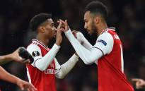 Arsenal's Gabonese striker Pierre-Emerick Aubameyang (R) comes on for Arsenal's English midfielder Reiss Nelson (L) during the UEFA Europa League Group F football match between Arsenal and Standard Liege at the Arsenal Stadium in London on 3 October 2019. Picture: AFP.
