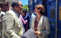 Commissioner Kate O'Regan and the police's lawyer Norman Arendse chatting at a Khayelitsha police station on 21 January 2014. Picture: Rahima Essop/EWN.