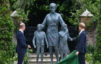 Britain's Prince William, Duke of Cambridge (L) and Britain's Prince Harry, Duke of Sussex unveil a statue of their mother, Princess Diana at The Sunken Garden in Kensington Palace, London on 1 July 2021, which would have been her 60th birthday. Picture: Dominic Lipinski/POOL/AFP