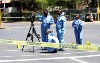Crime scene investigators at the scene in Bedfordview where Sam Issa was shot and killed on 12 October 2013. Picture: @EdenvaleJourno/Twitter