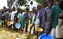FILE: Zimbabwean children line up for food. Picture: AFP