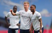 Manchester City's Ukrainian midfielder Oleksandr Zinchenko (L) and Manchester City's English midfielder Raheem Sterling gesture during the English Premier League football match between Crystal Palace and Manchester City at Selhurst Park in south London on May 1, 2021. Picture: Catherine Ivill /AFP