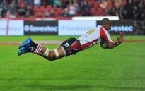 Lions player Lionel Mapoe dives to score a try, during a Super Rugby match against the Sharks on 2 June 2012. Picture: Mark Lewis/EWN