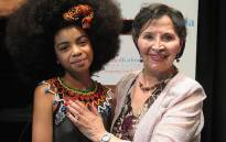 Zulaika Patel, a Pretoria Girls' High School pupil, is pictured with struggle her at toine Sophie De Bruyn at the Ahmed Kathrada annual lecture in Johannesburg on 15 October 2016. Picture: Louise McAuliffe/EWN.