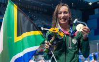 South Africa's Tatjana Schoenmaker with her goldmedal  after winning the final of the women's 200m breaststroke swimming event during the Tokyo 2020 Olympic Games on July 30, 2021.