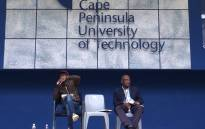 Cape Peninsula University of Technology vice-chancellor Dr Prins Nevhutalu, right, listens during a general assembly at its Bellville campus. Picture: Anthony Molyneaux/EWN.