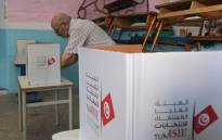 A Tunisian voter casts his ballot at a polling station in the capital Tunis on October 13, 2019 during the second round of the presidential election. Tunisians began voting today in a presidential runoff pitting conservative law professor Kais Saied against media magnate Nabil Karoui, who was released from prison just days earlier. Picture: AFP
