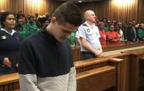 Nicholas Ninow (foreground) awaits judgment in his rape trial in the Pretoria High Court on 16 September 2019. Picture: Thando Kubheka/EWN