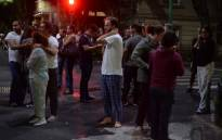 People gather on a street in downtown Mexico City during an earthquake on 7 September 2017. Picture: AFP