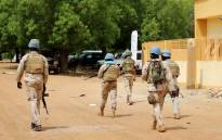 FILE: Senegalese soldiers of the UN peacekeeping mission in Mali MINUSMA (United Nations Multidimensional Integrated Stabilisation Mission in Mali) patrol on foot in the streets of Gao, on 24 July 2019. Picture: AFP