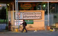 A correctional services official arrives for work at the Johannesburg Central Prison on Monday, 22 October 2012. Three prisoners were killed and 14 injured when the truck they were being transported in exploded not far from the prison situated south of the city. Picture: Werner Beukes/SAPA