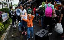 Chinese tourists disembark at Surat Thani Airport after tour operators were forced to suspend boats to tourist islands due to tropical storm Pabuk, in the southern Thai province of Surat Thani on 4 January, 2019. Picture: AFP