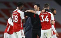 Arsenal coach Mikel Arteta and his team celebrate a 2-1 win against Tottenham on 14 March 2021. Picture: @arsenal/Twitter.