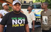 ANC member who assaulted a woman outside Luthuli House has been identified as Thabang Setona (Front-left). Picture: Ihsaan Haffejee/EWN.