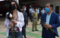 US pop singer Cher (L) holds a flower as she waits with Cambodia's Deputy Minister of Environment Neth Pheaktra (R) to greet the Asian elephant Kaavan upon his arrival in Cambodia from Pakistan at Siem Reap International Airport in Siem Reap on 30 November 2020. Picture: AFP.