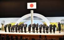 Representatives of bereaved families from the affected prefecture offer flowers at an altar for victims of the 2011 earthquake and tsunami disaster during the 8th national memorial service in Tokyo on 11 March 2019. Picture: AFP
