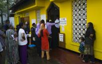 Voters queue up at a polling station to cast their ballots during the country's presidential election in Colombo on 16 November 2019. Picture: AFP