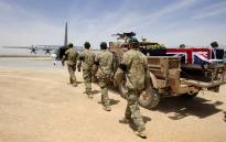 This handout photograph released by ISAF Regional Command (South) on May 29, 2011, shows a special forces bearer party walking alongside Sergeant Brett Wood's casket as he is driven to the awaiting C-130 aircraft at Tarin Kot Airfield, in Uruzgan, Afghanistan on May 28, 2011. Picture: AFP