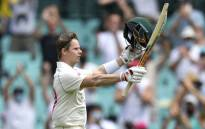 Australia's Steven Smith celebrates after scoring a century (100 runs) during the second day of the third cricket Test match between Australia and India at the Sydney Cricket Ground (SCG) in Sydney on 8 January 2021. Picture: Saeed Khan/AFP