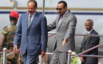 FILE: Eritrea president Isaias Afeworki (L) is welcomed upon arrival by Prime minister of Ethiopia Abiy Ahmed on 14 July, 2018 at Addis Ababa Bole International Airport for his official visit to Ethiopia. Picture: AFP