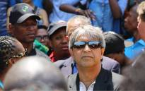 FILE: Wits University vice chancellor Adam Habib stands surrounded by students during a third day of protests at the institution over proposed tuition fee increases on 16 October 2015. Picture: Reinart Toerien/EWN