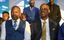 FILE: Umbrella for Democratic Change (UDC) leader Boko Duma (L) and vice president Dumelang Saleshando listen at a rally campaign for the general elections in Gaborone on 19 October 2019. Botswana will have their general election on 23 October 2019. Picture: AFP