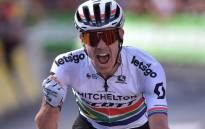South Africa's Daryl Impey celebrates as he wins on the finish line of the ninth stage of the 106th edition of the Tour de France cycling race between Saint-Etienne and Brioude, in Brioude, eastern France, on July 14, 2019.  Picture: AFP.