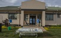 Medical personnel dressed in personal protective equipment are seen at a lodging building readying for their turn to go and work inside the main COVID-19 treatment centre at Kamuzu Central Hospital in Lilongwe, Malawi, on January 18, 2021. Picture: AMOS GUMULIRA/AFP